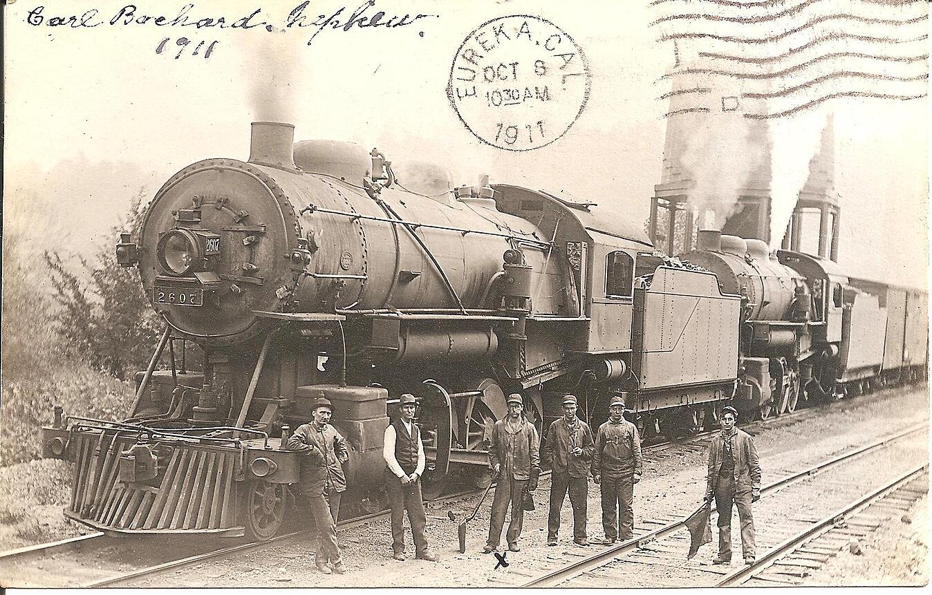 Old photograph of train and workers